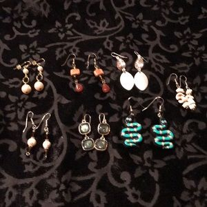 Seven pairs of fashion wire earrings.